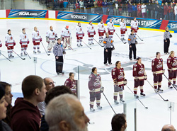 Both teams line up for the anthem on the ice before the game starts